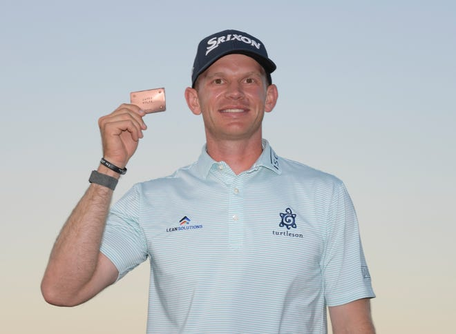 Jared Wolfe displays his PGA Tour membership card after finishing in a tie for second last week in the Pinnacle Bank Championship in Omaha, Neb. Wolfe is eighth on the Korn Ferry Tour points list, with the three-event Korn Ferry Finals beginning this week in Boise, Idaho.
