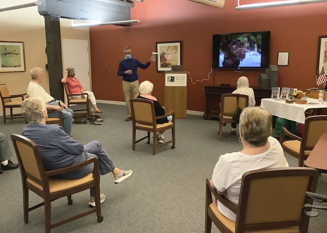 Author Thomas Farmen discusses his book with residents of Heywood Wakefield Commons in Gardner.