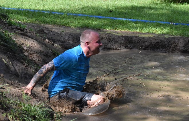 Case Creek Obstacles hosted its ninth annual mud run on Saturday morning, Aug. 14. During the run, mud pits required walking or crawling up terraces, then sliding into mud pits and crawling under ropes. Rinse and repeat.
