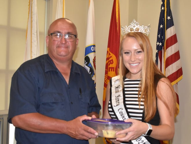 Orion Fire Chief Doug Smutzer, left, receives baked goods from Henry County Fair Queen Katie Noyd, right, on Thursday morning, Aug. 12. Noyd wanted to show her appreciation for first responders before leaving for the Illinois State Fair in Springfield, where she represented Henry County.