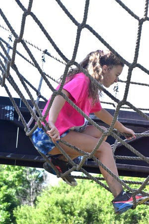 Case Creek Obstacles, rural Coal Valley, held its ninth annual 5K mud run on Saturday morning, Aug. 14. One of the challenges was a cargo net with competitors trying to walk, or crawl, or roll between two towers.