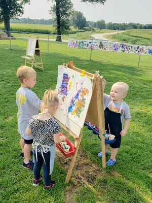 Among the young artists at Geneseo Child Care are Bodey Mickley, Lennen Shannon and Reed Robertson