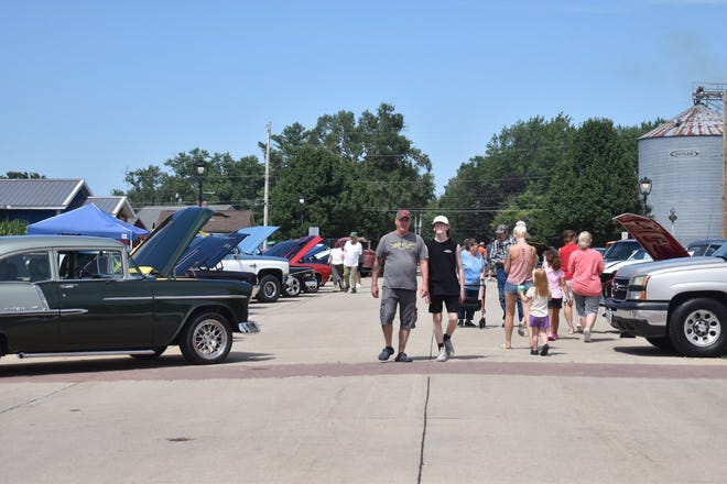 Cambridge Rotary Club's annual car show draws a crowd to Prospect Street on Saturday, Aug. 14.