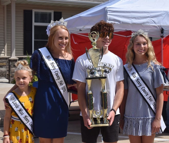 Meric Veloz of Cambridge, third from left, receives the Best High School Entry from Henry County Fair royalty at the Cambridge Rotary Club's car show on Saturday, Aug. 14. From left, the queens are Little Miss Ivery Hull, Miss Henry County Fair Katie Noyd and Junior Miss Bella VanOpdorp. Veloz showed a 1970 Chevy Nova.