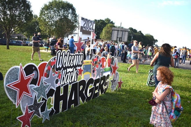 """""""Welcome back Chargers"""" was a popular photo op east of C.R. Hanna Elementary School, Orion, on the first day of class, Monday morning, Aug. 16."""