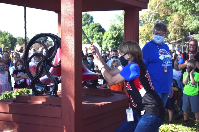 """On the first day of the new school year, one of the traditions is ringing the bell at the west end of C.R. Hanna Elementary School, Orion. On Monday, Aug. 16, the honor of ringing the bell belong to two teachers who are retiring in May. Robin Tuttle pulls the rope while Sharon Peterson, right, waits her turn. """"We declare to Orion that school is back in session,"""" Principal R.C. Lowe said."""