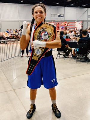 U.S. Marine Corps 1st Lt. Stephanie Simon of the II Marine Expeditionary Force (II MEF) Martial Arts Center of Excellence (MACE) boxing team poses for a photo after winning the 152-lbs. female division of the 2021 Golden Gloves National Tournament of Champions held in Tulsa, Oklahoma, Aug. 9-14.