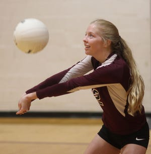 Dixon senior Ellis Griggs keeps her eyes on the ball as the Bulldogs warm up before a match against Southwest last week.