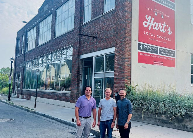 RDG+Partners starts construction at the site of its new offices at 10 Winthrop St. in Rochester. Pictured, from left, are Matt Lester, Dennis Wilmot and Dan Matteo.