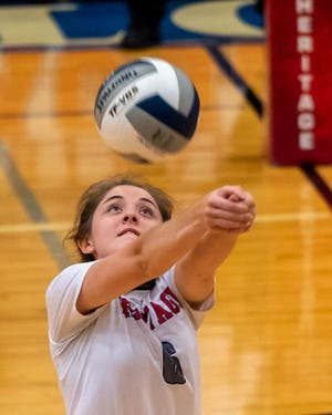 Heritage's Kensey Clifton receives a serve during a match last September. The Jaguars' season got underway last week with six wins against strong competition.