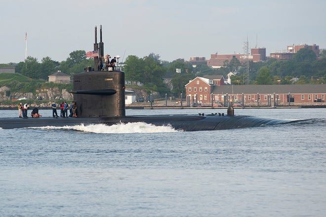 USS Newport News (SSN 750) makes its way up the Thames River and past the City of New London returning to Submarine Base New London after routine operations on Wednesday, August 11, 2021.  The Los Angeles-class submarine is the third Naval ship to be named for Newport News, Virginia and the last second flight submarine in the class.