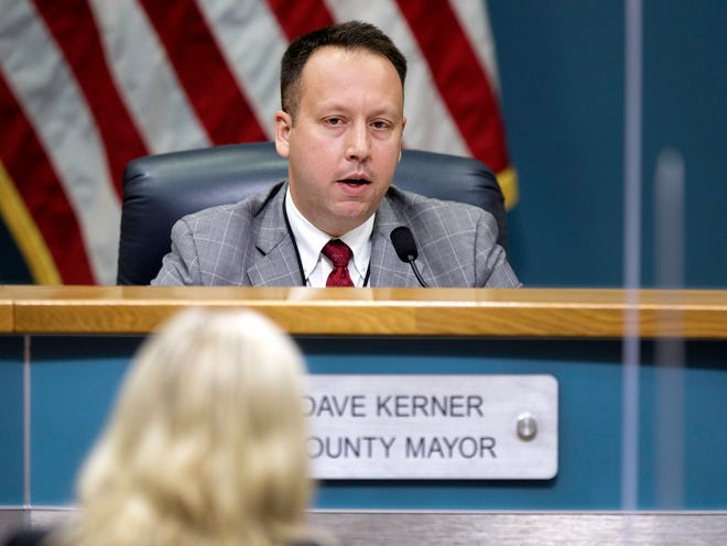 Dave Kerner, Palm Beach County mayor, talks with Darcy J. Davis, CEO of the Health Care District of Palm Beach County, about COVID-19 conditions during the County Commission meeting in West Palm Beach Tuesday, Aug. 17, 2021.