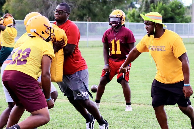 Rashad Jackson (far right) returned to Belle Glade from Oceanside Collegiate Academy (Mt. Pleasant, S.C.) to take the position of head coach at his alma mater, Glades Central, in February of 2020.
