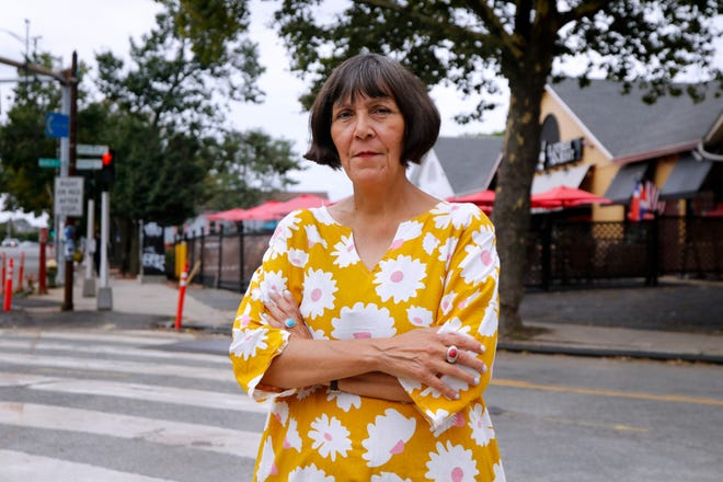 Marta Martinez, executive director of Rhode Island Latino Arts, stands at the former site of Fefa's Market, at the intersection of Broad and Baker streets in Providence.