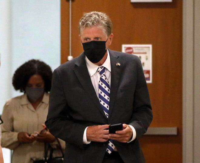 Masks on, Gov. Dan McKee and Lt. Gov. Sabina Matos head into Tuesday's news conference at the Department of Administration.