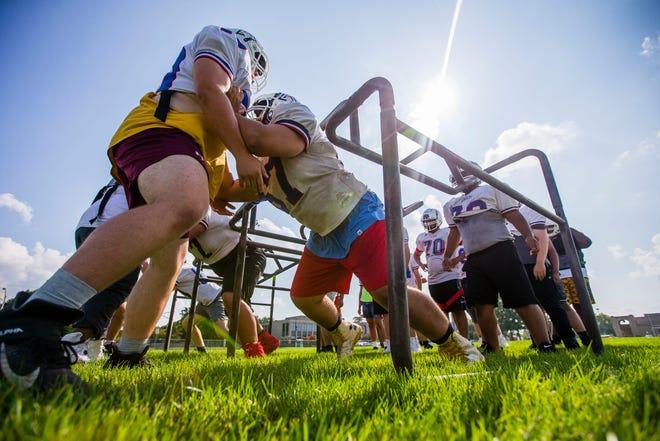 Adams players run drills during practice Tuesday, Aug. 17, 2021 at Adams High School.