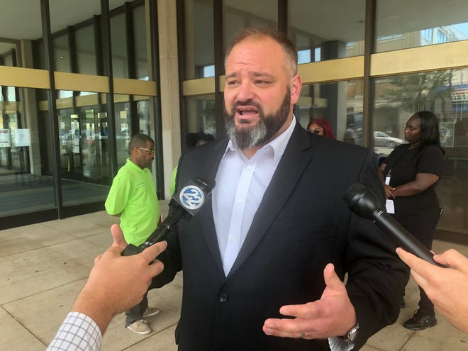 Joshua Reynolds, South Bend's former community police review office director, speaks to reporters  Aug. 9 in front of the County-City Building.