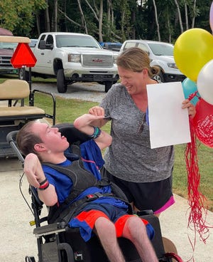 Johnathan Huffstetler and his mother Dorothy Edwards share a smile during his birthday celebration.
