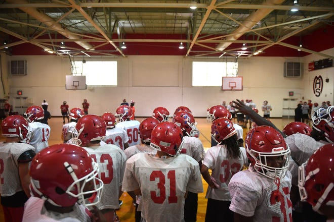 The Manatee High School football team moved their practice into the gym on Thursday, Aug. 12, 2021 due to lightning strikes within five miles of the practice field.