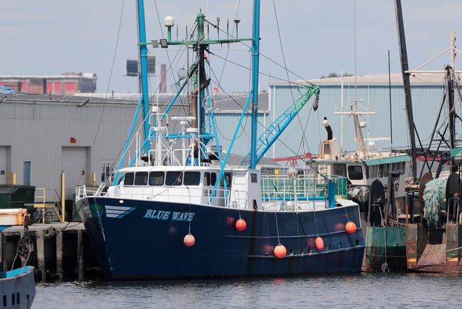 The Blue Wave fishing boat returns to the dock in front of the Blue Harvest Fisheries in New Bedford.