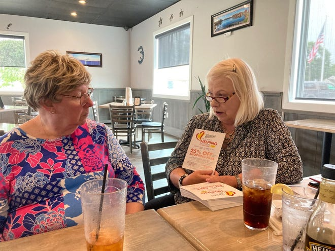 The General Federation of Women's Clubs Zwaanendael Women's Club announced donors can earn a Boscov's 25% discount shopping pass by making a $5 donation to the club. Pictured, Z Club President Vickie Burrier, right, explains the Donate and Earn Discounts program to Judy Pagani.