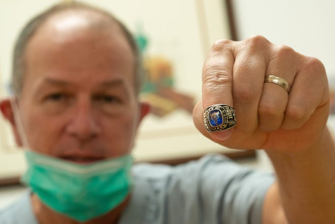 Jim Schwartz, owner of King Pharmacy, 4033 S.W. 10th Ave., shows off his 1984 class ring from the University of Kansas on Tuesday. Thanks to the generosity of a random stranger in Minneapolis, Minn., Schwartz was reunited with his ring after losing it in 1987.