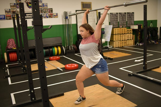 Rylie Rohloff of Westborough exhibits her technique last week at Prototype Training Systems.
