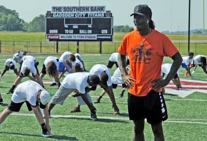 Football star Dre Kirkpatrick is shown during a 2019 youth football camp at Gadsden City High School, his alma mater.