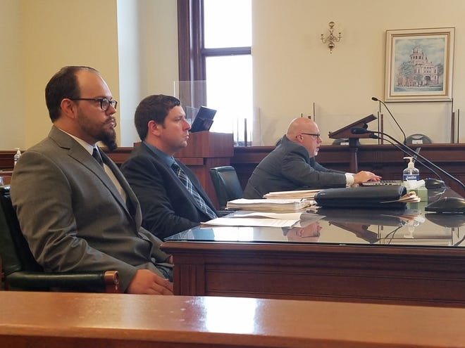 Dresden E. Korns (left) sits in Tuscarawas County Common Pleas Court on Tuesday with his attorney Mark Perlaky (center) and assistant Stark County prosecutor Scott Deedrick. Korns pleaded guilty to four charges in connection with a Dec. 4 shooting in the Newcomerstown area that injured his brother.