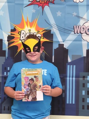 Costume-clad kids flocked to the Van Alstyne Public Library August 14 for free comic book day. All those who came received free masks and got to enjoy the superhero photo both.  With so many super heroes in one place, the bad guys didn't stand a chance.