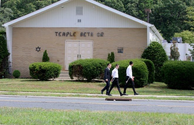 Boys walk in front of the former Temple Beth Or on Van Zile Road in Brick Township Tuesday, August 17, 2021.  The new owners of the site began operating it as an Orthodox Jewish boy's high school before they obtained required township approvals, according to Brick officials.
