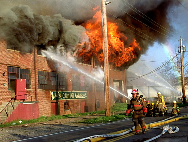 Asheville firefighters battle the blaze that consumed the Asheville Cotton Mill on April 2, 1995.