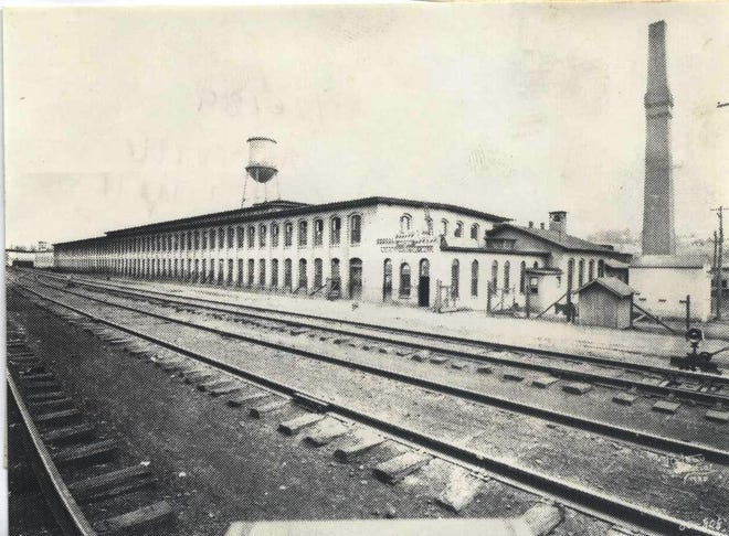 Asheville Cotton Mill, opened by C.E. Graham in 1887, was one of the first industries in Asheville. The mill, on Riverside Drive near the Old Smith Bridge, was operated by Cone Mills of Greensboro until 1953. The hillside above the mill was known as Factory Hill.