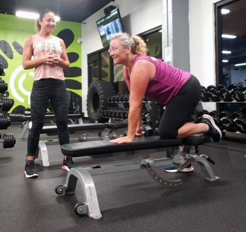 Nicole Velez of Club Performax working with Edith Lynch on a new fitness routine.