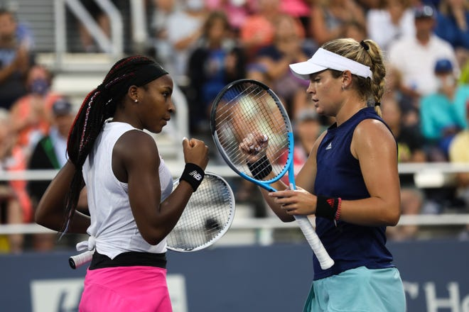 Coco Gauff (left) and Caty McNally (right) bump fists after a play against Alexa Guarachi and Desirae Krawczyk at the 2021 Western and Southern Open on Monday August 16, 2021. McNally and Gauff won the match.