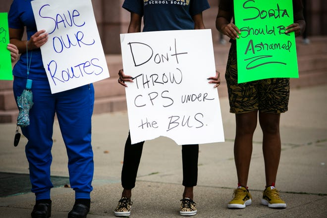 Demonstrators with the Cincinnati Federation of Teachers, parents and community members rally in front of City Hall on Tuesday, August 17 to demand Mayor Cranley, City Council and Hamilton County Commissioners to compel SORTA Appointees to restore CPS school routes.
