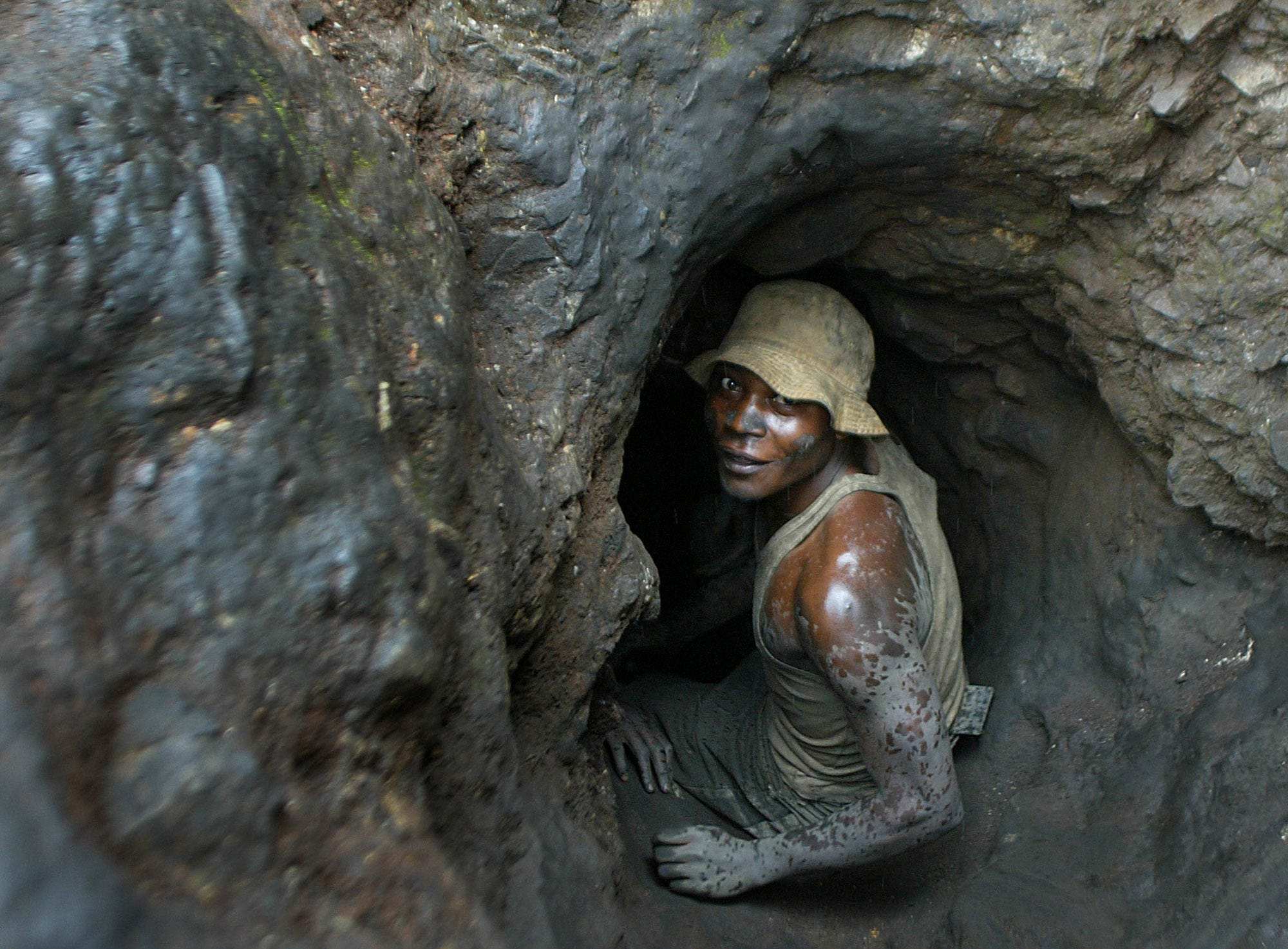 A man enters a tunnel dug with shovels in the Shinkolobwe cobalt mine in the Democratic Republic of Congo. The country is where half of the world's cobalt is located.