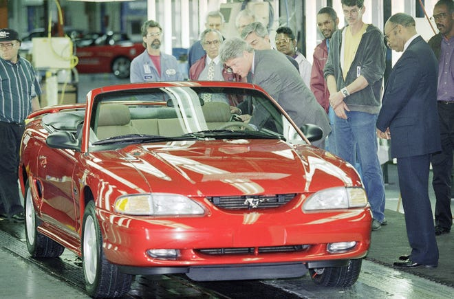 Then-President Bill Clinton looks over a Ford Mustang during a tour of the assembly plant in Dearborn in the fall of 1994. The pony car in 1995 offered a purist-focused one-year special, the GTS, a no-frills version of the V8-powered GT.
