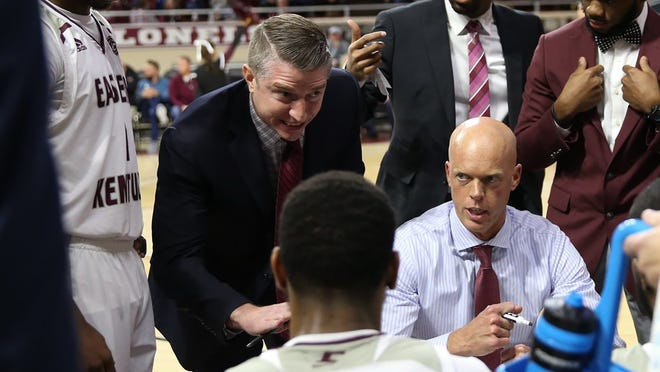 Memorial graduate and Eastern Kentucky assistant Patrick Blake (left) gives instructions to the Colonels.