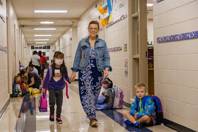 Kindergarten teacher Meredith Partridge helps Dianna Ortiz Villa find her classroom at Blythe Academy. Tuesday August 17, 2021