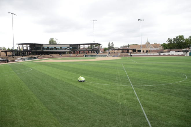 A robot from  GPS Lining paints the lines on the artificial turf of Loeb Stadium for two soccer pitches to be used by the Lafayette Jeff High School Soccer teams, Monday, Aug. 16, 2021 in Lafayette.
