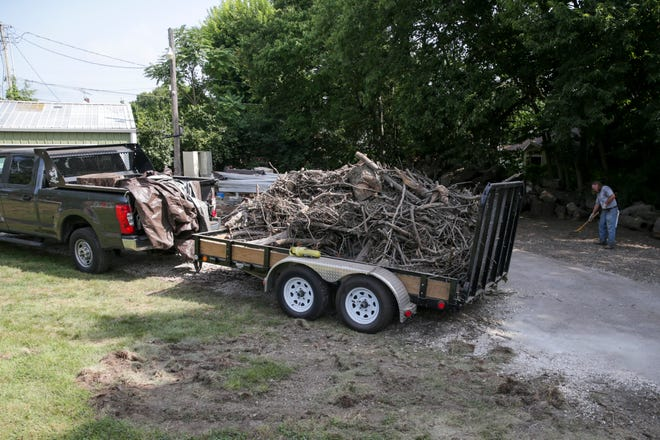 The brush pile that was once on the side of the Greenbush Cemetery shed yard now sits in the bed of a Fairfield Township trailer, Tuesday, Aug. 17, 2021 in Lafayette.
