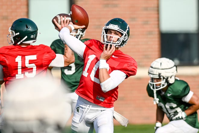 MSU redshirt sophomore Payton Thorne (10) spent August competing for the starting quarterback job with transfer Anthony Russo (15). LSJ columnist Graham Couch believes Thorne will be the starter at Northwestern.