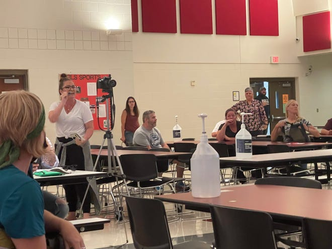 An angry parent yells at the Marion City School Board of Education during a meeting on Monday night where the school reiterated its mask requirement for the upcoming school year.