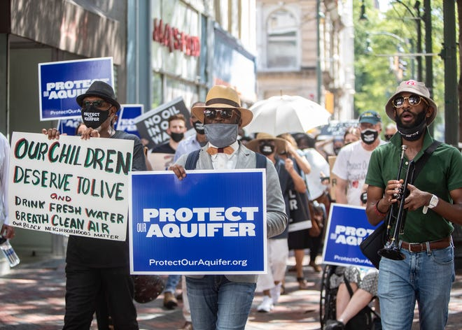 Protesters march from the National Civil Rights Museum to City Hall to advocate for City Council to pass a resolution creating a legislative regulatory body to protect the aquifer on Tuesday, Aug. 17, 2021.