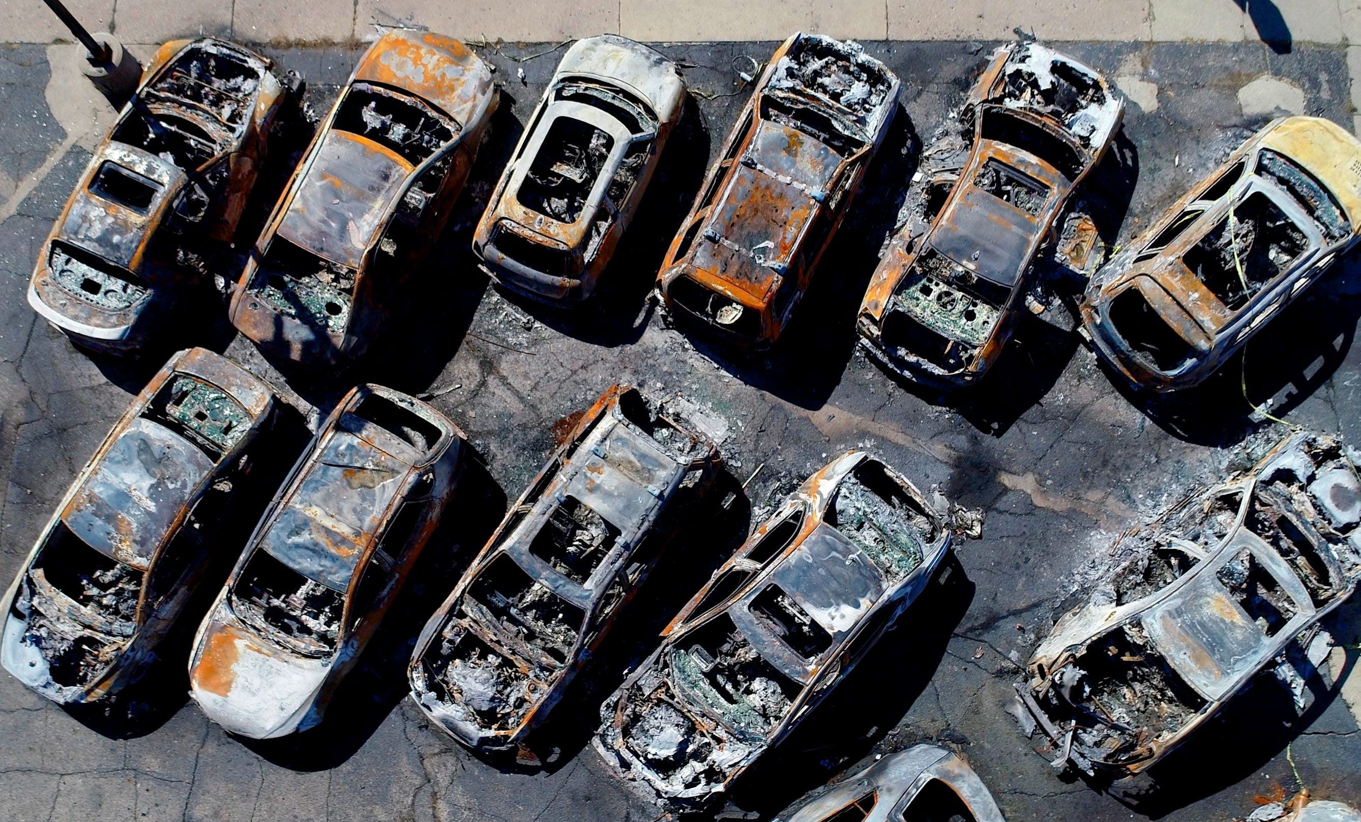 Vehicles sit destroyed after burning at Car Source on Sheridan Road, in Kenosha September 2, 2020. The destruction came as the aftermath consecutive nights of violent protests following of the shooting of Jacob Blake.