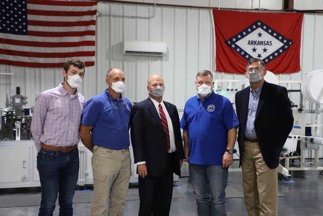 Congressman Rick Crawford (center right) and former Arkansas State legislator David Branscum (center left) pose for a photo with The Maskeeter team.