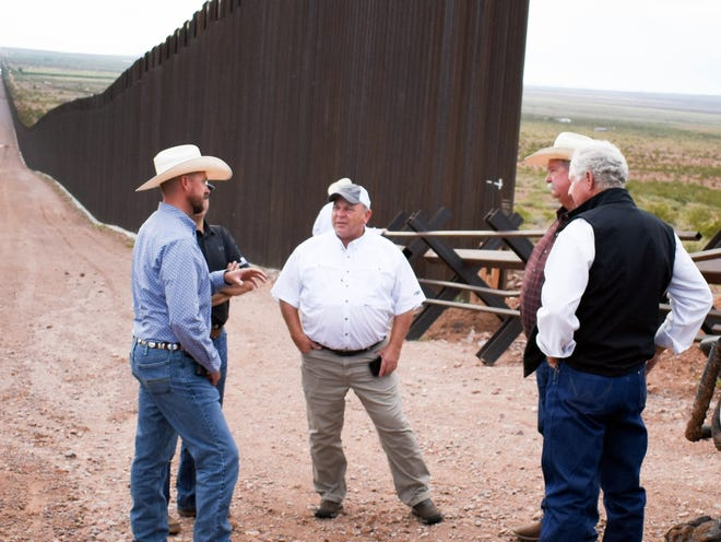 From left, Luna County FLB President and area rancher Russell Johnson explains how the increase in border traffic is affecting his family and ranch. In the background is the end of the wall. On the tour was NMF&LB President Chad Smith, AFBF President Zippy Duvall, Russell's father Joe Johnson and NMF&LB President Craig Ogden.