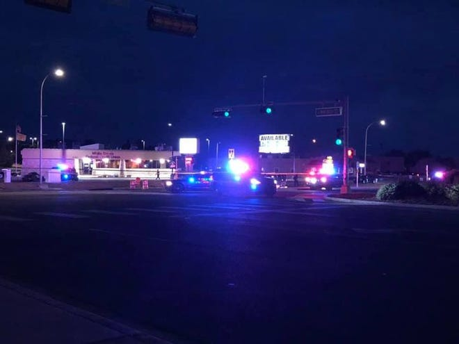 Las Cruces police investigate a shooting at the intersection of Lohman Avenue and Walnut Street on Monday, Aug. 16, 2021.