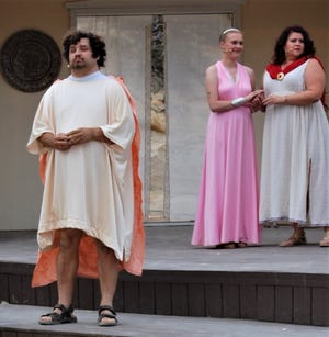 """Ben Burns, Rebekah Cochran and Annette DiGiacomo are featured in a scene from the Theater Ensemble Arts presentation of """"A Midsummer Night's Dream"""" continuing Aug. 19-21 at the Lions Wilderness Park Amphitheater in Farmington."""